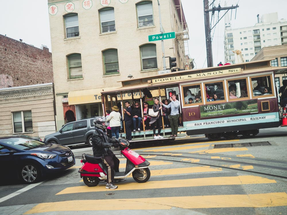 Powell Street Cable Car and Motorcyclist | Carla Gabriel Garcia